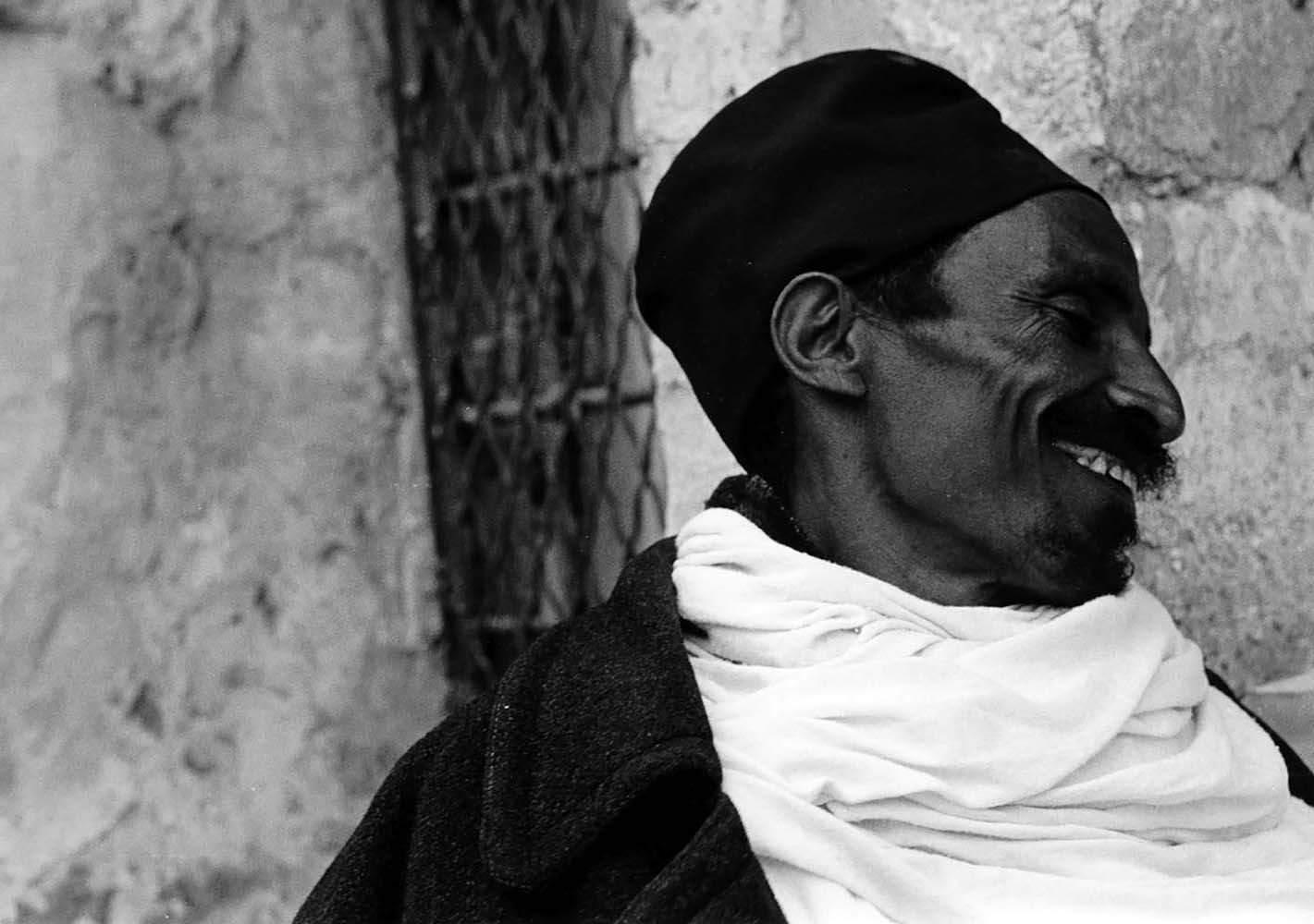 "<span class=""caption-title"">Ethiopian Monk Ethiopian Monestary</span>, Jerusalem, Israel, 1976<span class=""caption-copyright"">© Rodney Smith</span>"