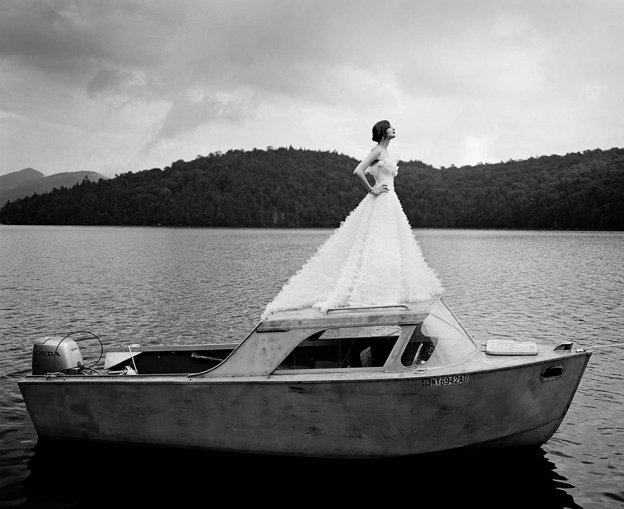 "<span class=""caption-title"">Laura on top of Boat</span>,  Lake Placid, New York, 2006<span class=""caption-copyright"">© Rodney Smith</span>"