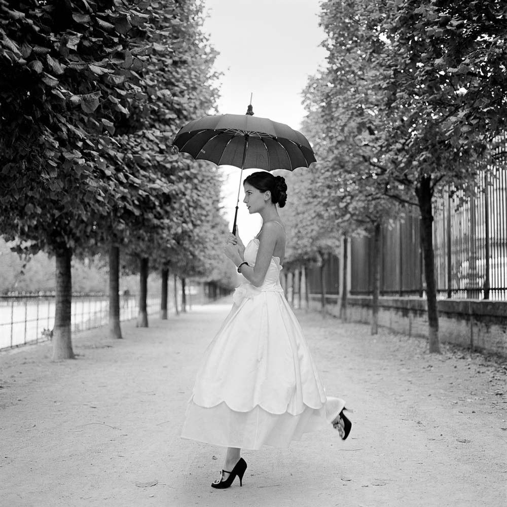 "<span class=""caption-title"">Mira Skipping with Umbrella</span>,  Paris, France, 2007<span class=""caption-copyright"">© Rodney Smith</span>"