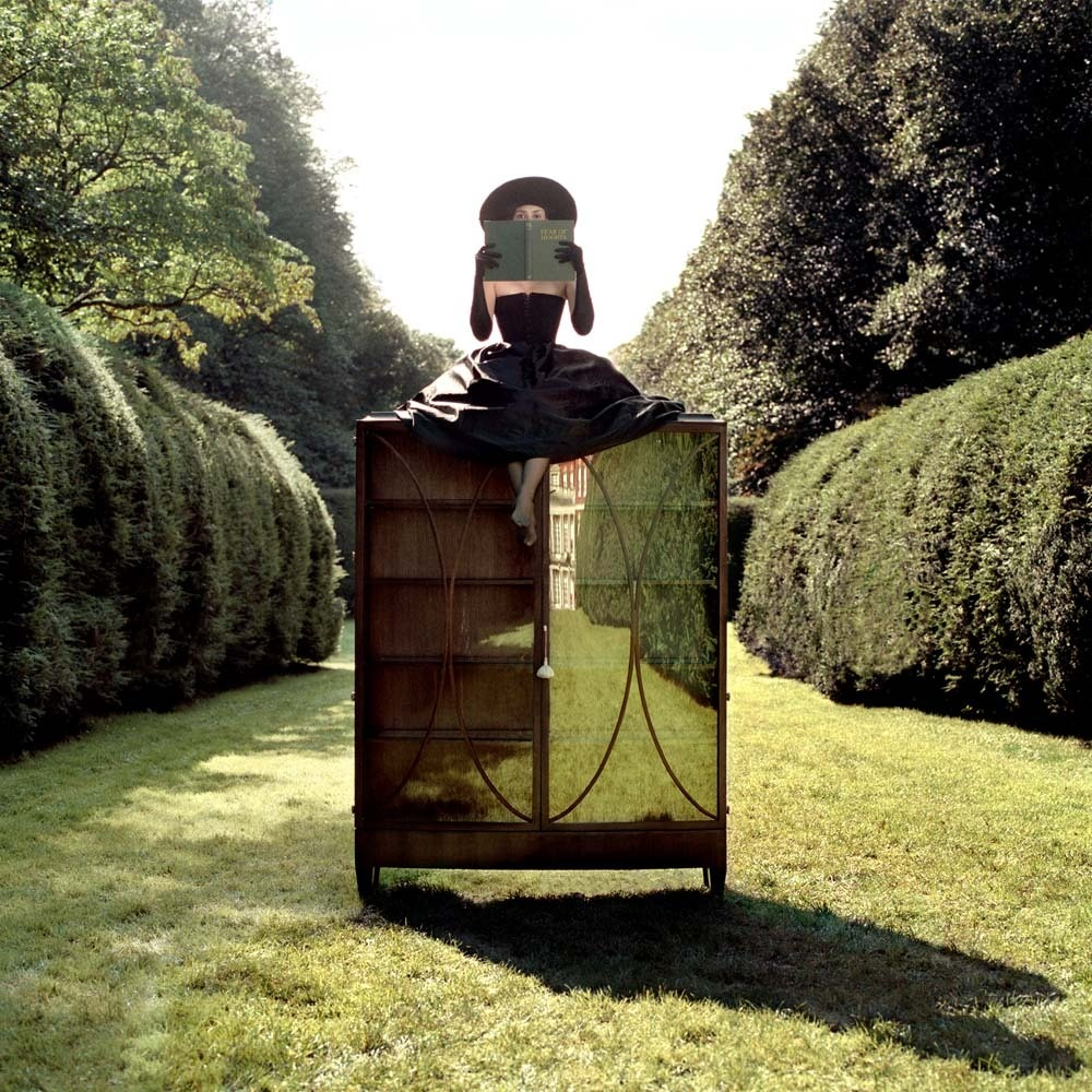 "<span class=""caption-title"">Woman with Hat between Hedges</span>, Parc de Sceaux, France, 2004<span class=""caption-copyright"">© Rodney Smith</span>"