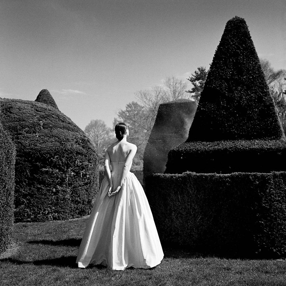 "<span class=""caption-title"">Bernadette in White Dress from behind</span>, Longwood Gardens, Pennsylvania, 1997<span class=""caption-copyright"">© Rodney Smith</span>"