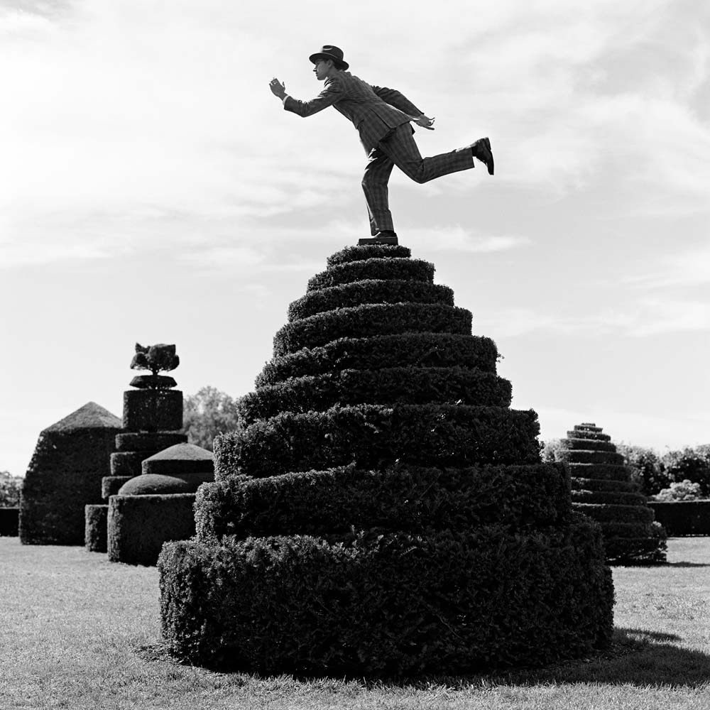 "<span class=""caption-title"">Reed Balancing on top of Topiary</span>, Longwood Gardens, Pennsylvania, 2013<span class=""caption-copyright"">© Rodney Smith</span>"
