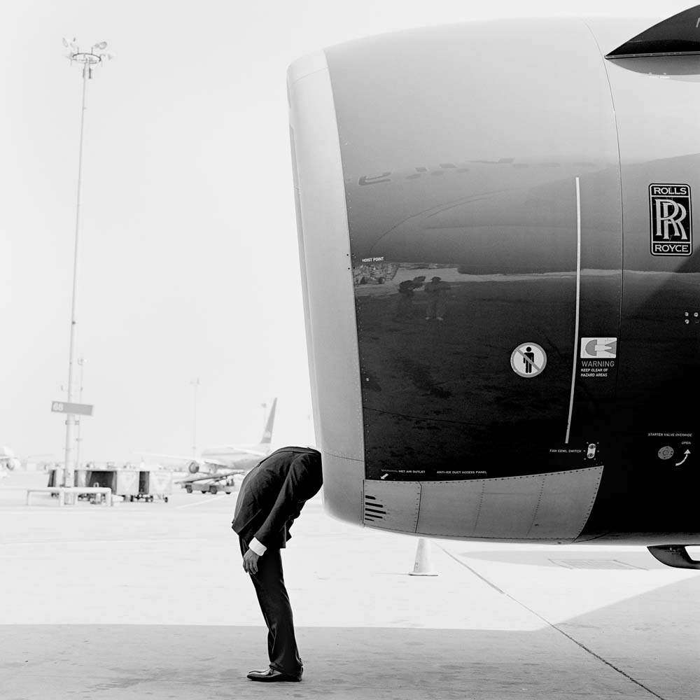 "<span class=""caption-title"">Jonathan with Head in Engine</span>, JFK Airport, New York, 2007<span class=""caption-copyright"">© Rodney Smith</span>"