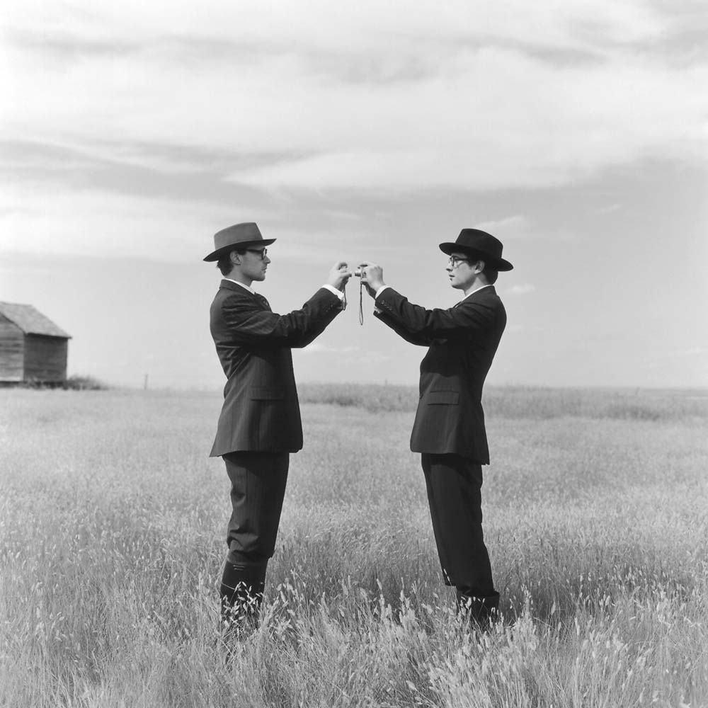 "<span class=""caption-title"">Greg and Collin Photographing each other in Field</span>, Alberta, Canada, 2004<span class=""caption-copyright"">© Rodney Smith</span>"