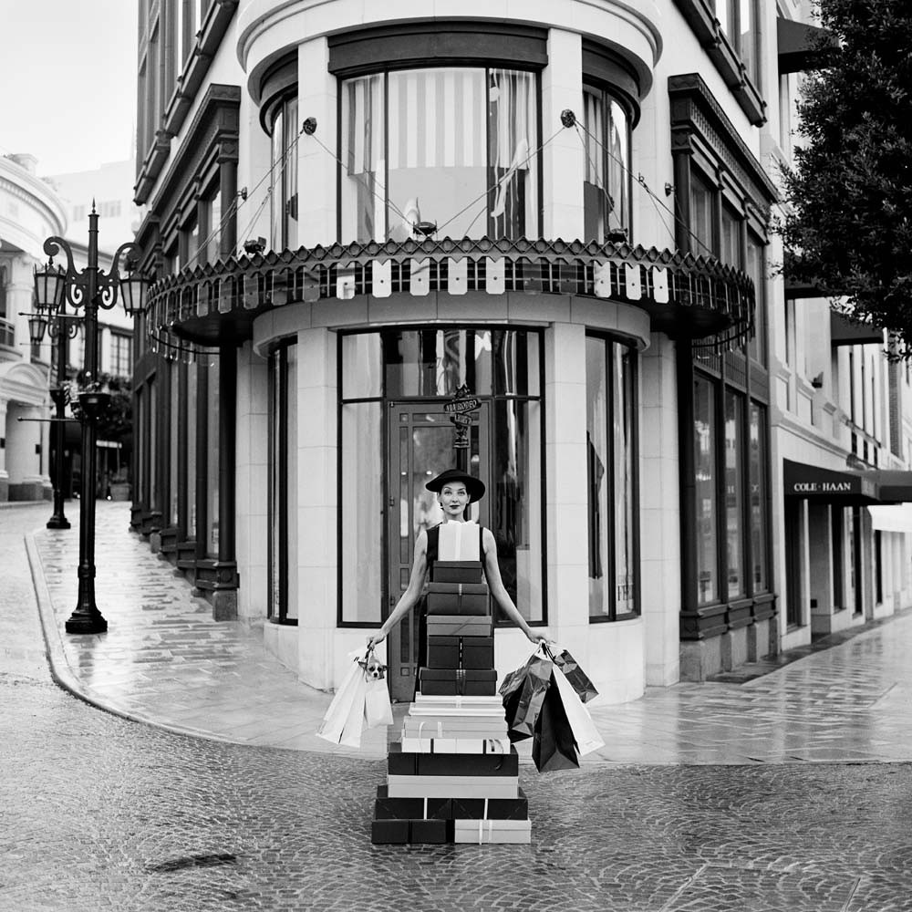 "<span class=""caption-title"">Woman with Chihuahua on Rodeo Drive</span>, Beverly Hills, California, 1998<span class=""caption-copyright"">© Rodney Smith</span>"