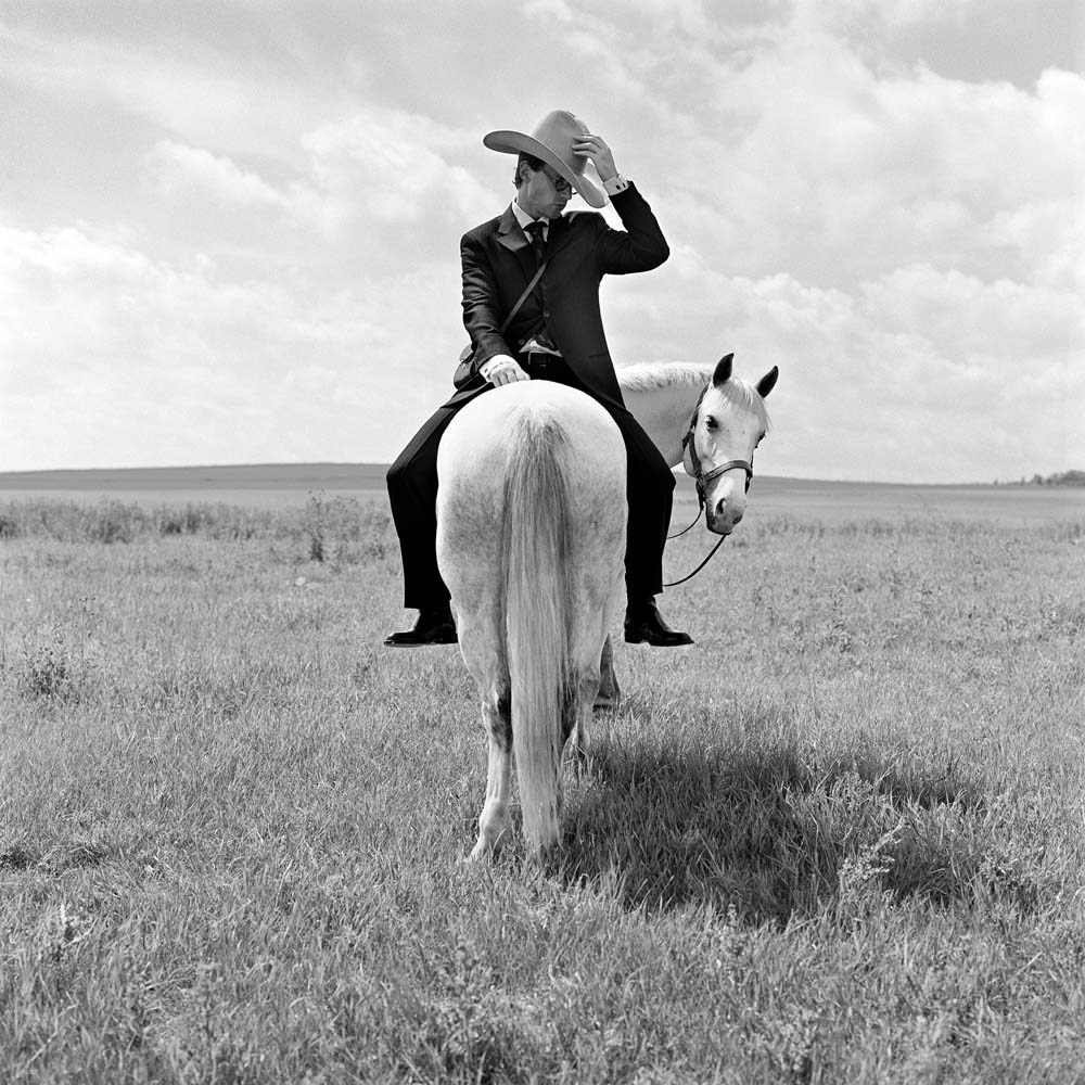 "<span class=""caption-title"">Greg on Horse Backwards</span>, Alberta, Canada, 2004<span class=""caption-copyright"">© Rodney Smith</span>"