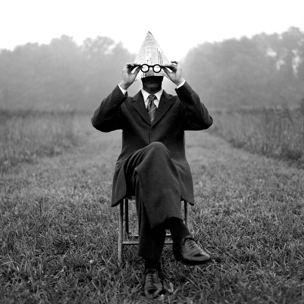 "<span class=""caption-title"">Man with Newspaper Hat</span>, Monkton, Maryland, 1999<span class=""caption-copyright"">© Rodney Smith</span>"