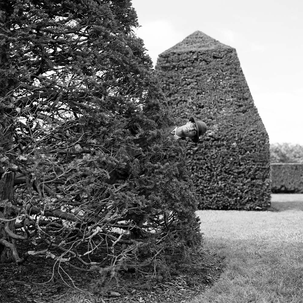 "<span class=""caption-title"">Reed Popping out from Behind Hedge</span>, Longwood Gardens, Pennsylvania, 2013<span class=""caption-copyright"">© Rodney Smith</span>"