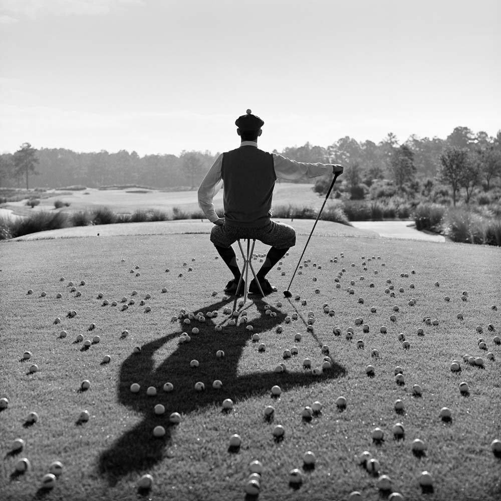 "<span class=""caption-title"">AJ Seated with Golf Balls</span>, St. Augustine, Florida, 2002<span class=""caption-copyright"">© Rodney Smith</span>"