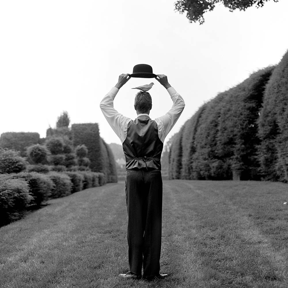 "<span class=""caption-title"">Don with Bird Under Hat</span>, Monkton, Maryland, 1999<span class=""caption-copyright"">© Rodney Smith</span>"