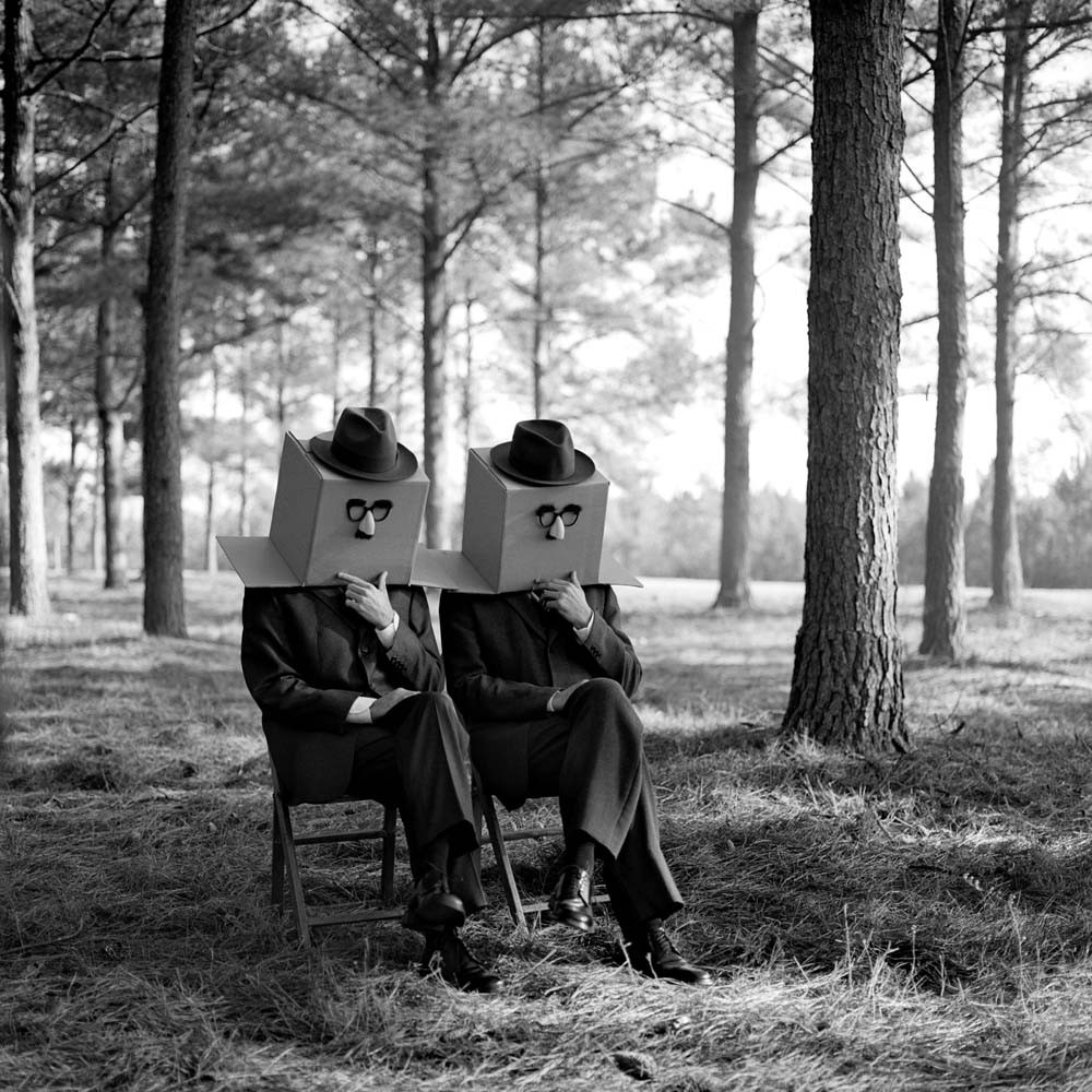 "<span class=""caption-title"">Men with Boxes on Head</span>, Brunswick, Georgia, 2001<span class=""caption-copyright"">© Rodney Smith</span>"
