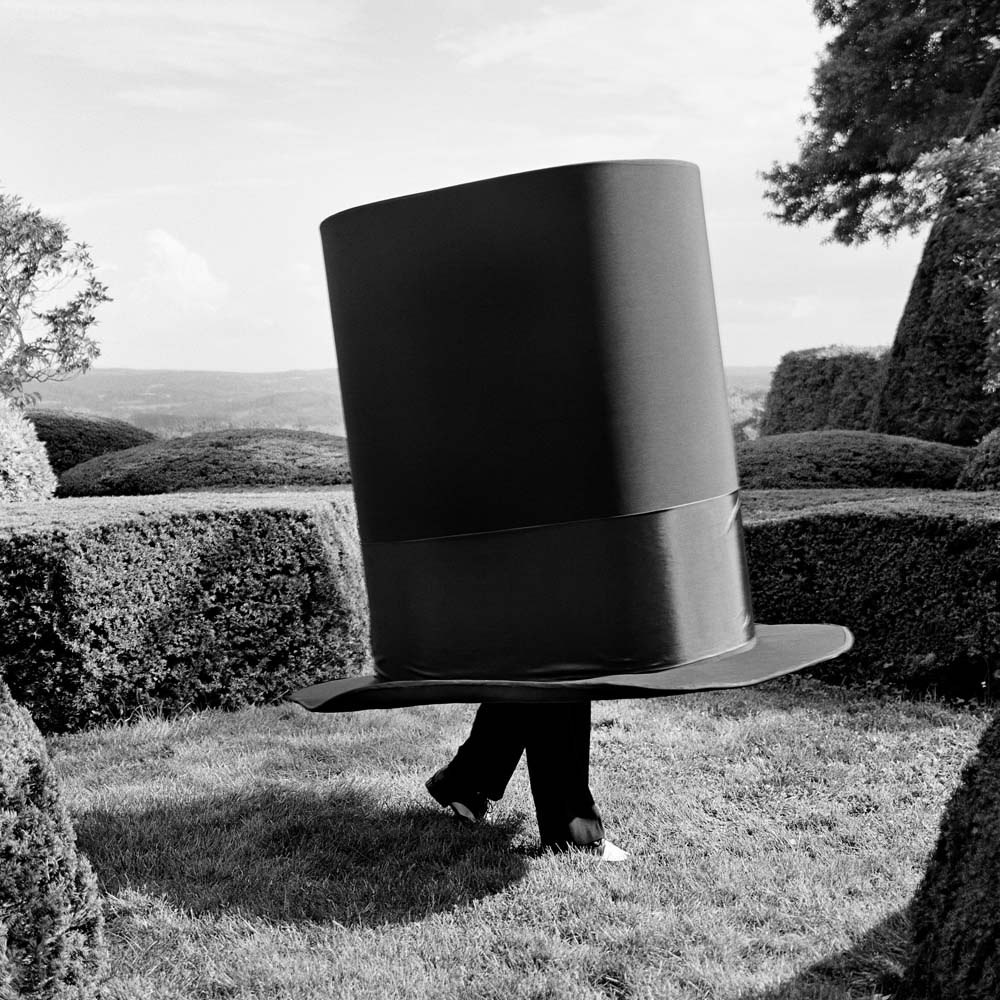 "<span class=""caption-title"">Man Inside Giant Top Hat</span>, Amenia, New York, 2014<span class=""caption-copyright"">© Rodney Smith</span>"