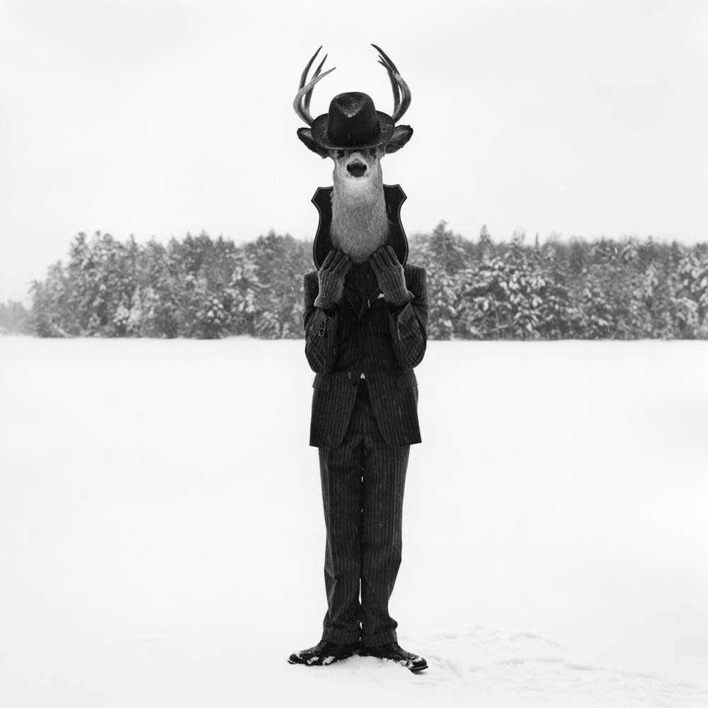 "<span class=""caption-title"">Man with Deer Head</span>, Lake Placid, New York, 2008<span class=""caption-copyright"">© Rodney Smith</span>"