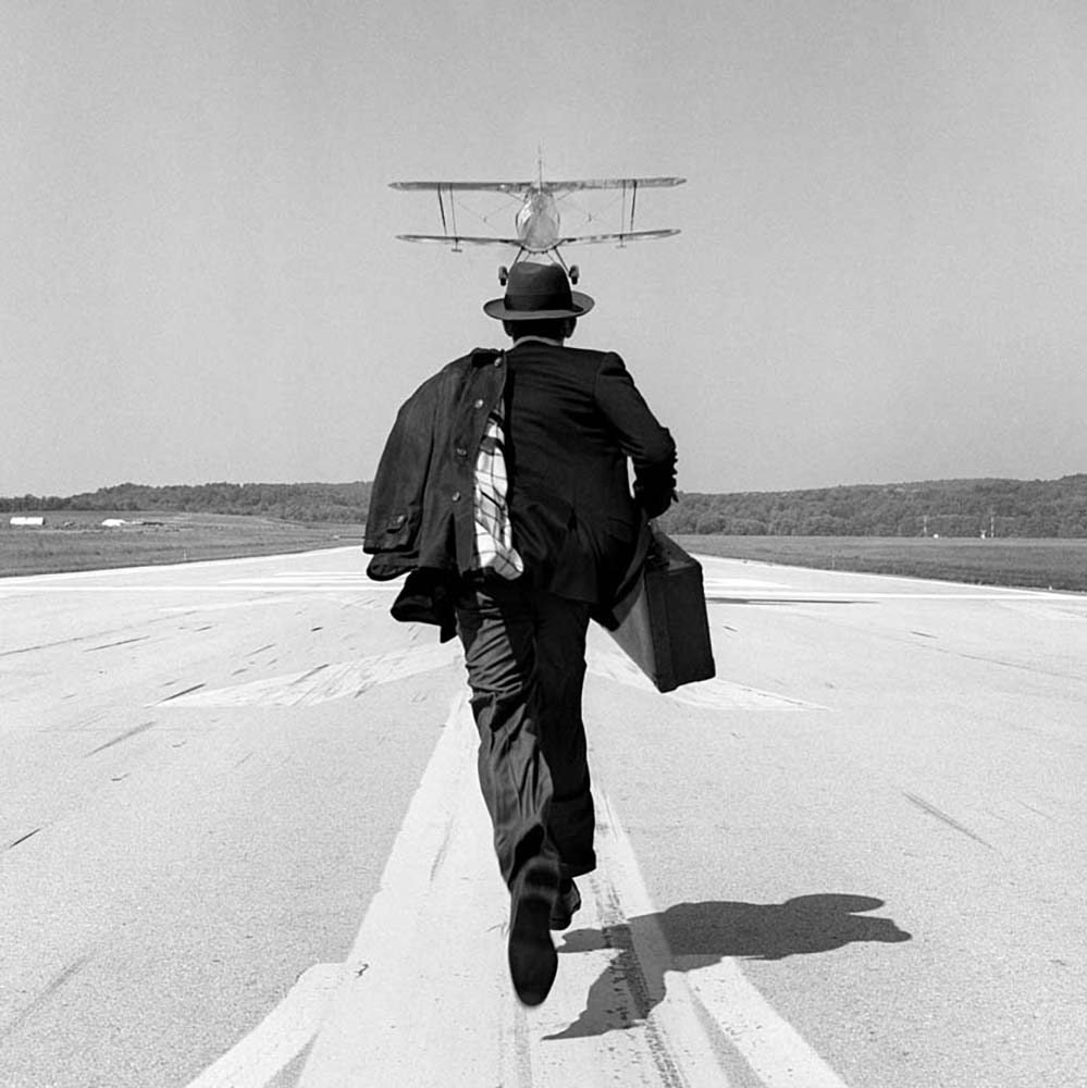 "<span class=""caption-title"">AJ Chasing Airplane</span>, Orange County Airport, New York, 1998<span class=""caption-copyright"">© Rodney Smith</span>"