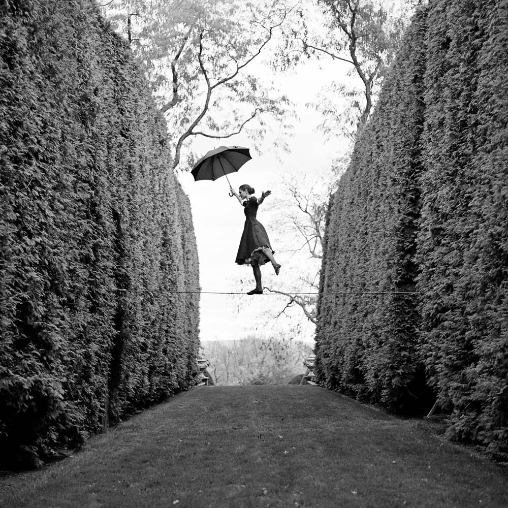 "<span class=""caption-title"">Kelsey Balancing on Tightrope</span>, Amenia, New York, 2013<span class=""caption-copyright"">© Rodney Smith</span>"