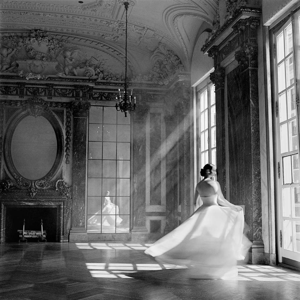 "<span class=""caption-title"">Bernadette Twirling</span>, Burden Mansion, New York City, New York, 1997<span class=""caption-copyright"">© Rodney Smith</span>"