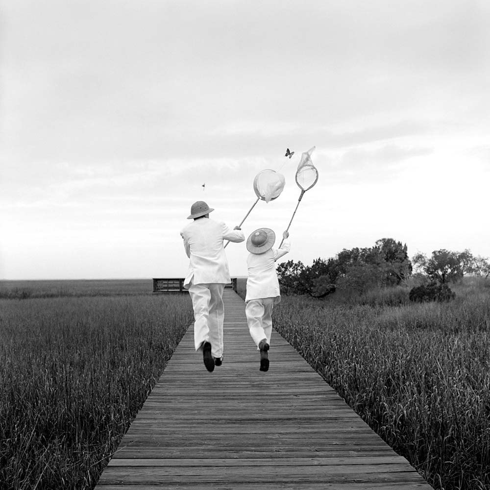 "<span class=""caption-title"">Gary And Henry Chasing Butterfly</span>, Beaufort, South Carolina, 1996<span class=""caption-copyright"">© Rodney Smith</span>"