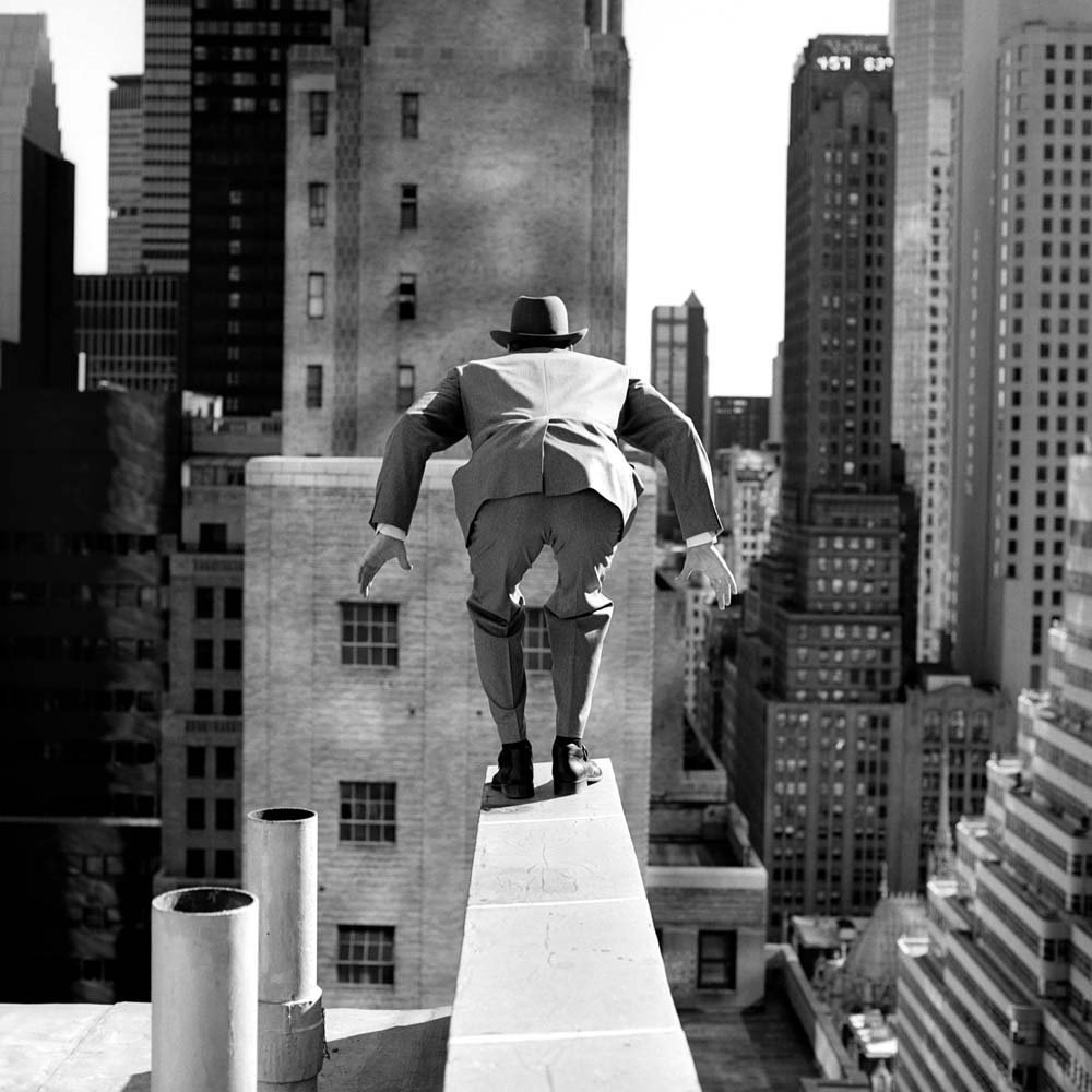 "<span class=""caption-title"">Alan Leaping From 515 Madison Avenue</span>, New York City, New York, 1996<span class=""caption-copyright"">© Rodney Smith</span>"