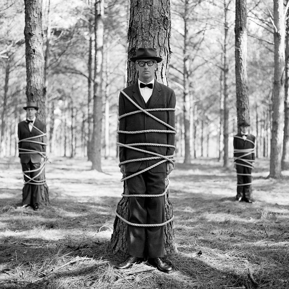 "<span class=""caption-title"">Three Men Tied to Trees</span>,  Brunswick, Georgia, 2001<span class=""caption-copyright"">© Rodney Smith</span>"