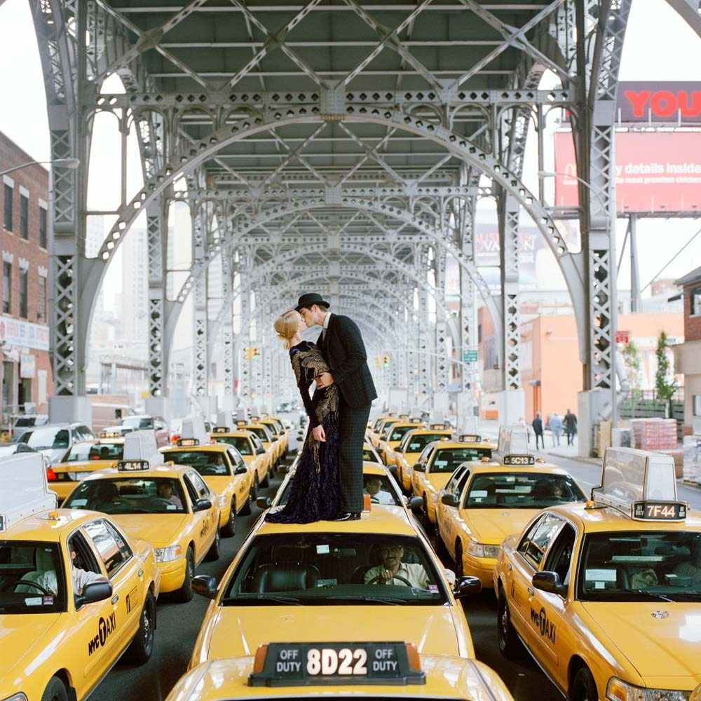 "<span class=""caption-title"">Edythe and Andrew Kissing on Top of Taxis</span>,  New York City, New York, 2008<span class=""caption-copyright"">© Rodney Smith</span>"
