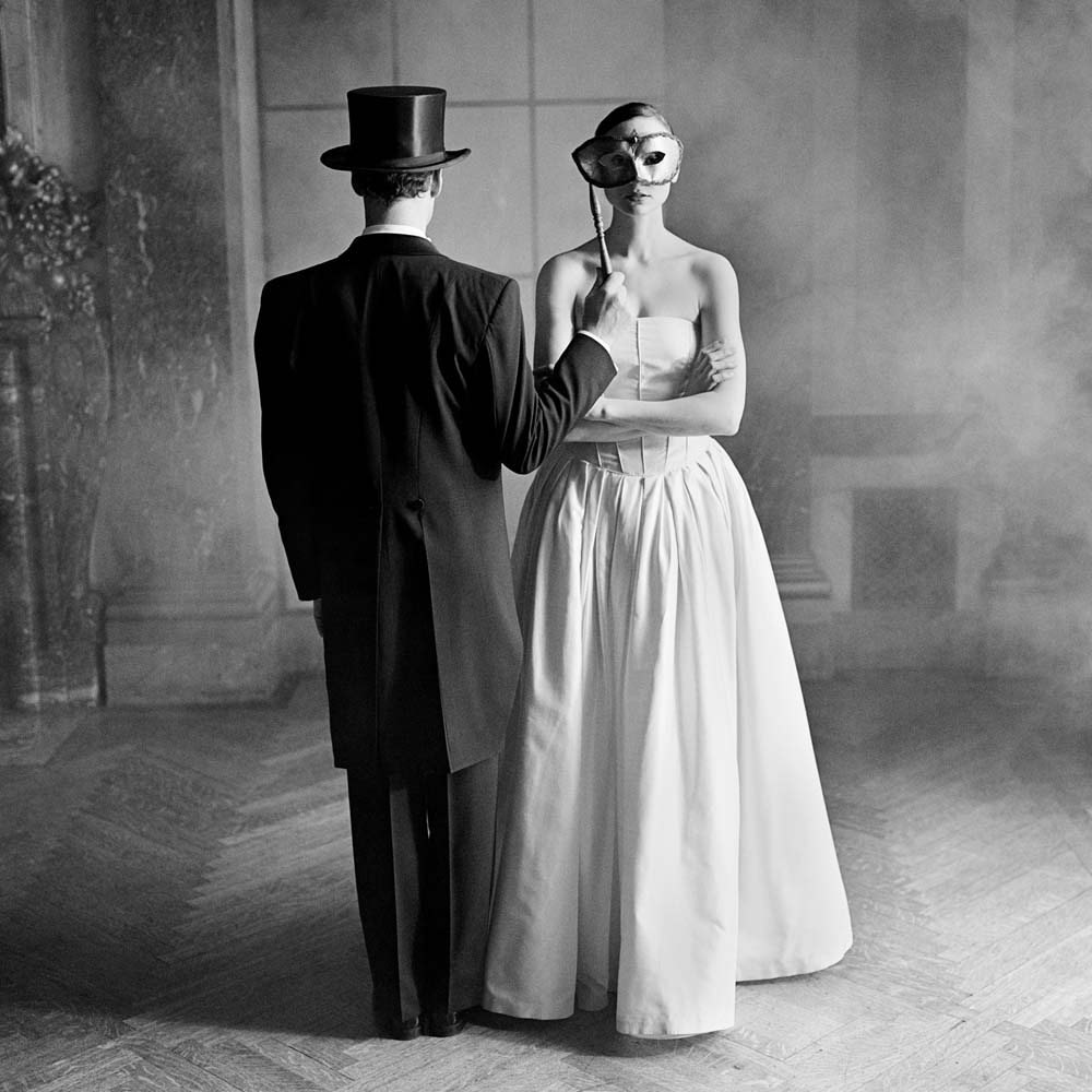 "<span class=""caption-title"">Tim Holding Mask to Bernadette</span>,  Burden Mansion, New York City, New York, 1997<span class=""caption-copyright"">© Rodney Smith</span>"