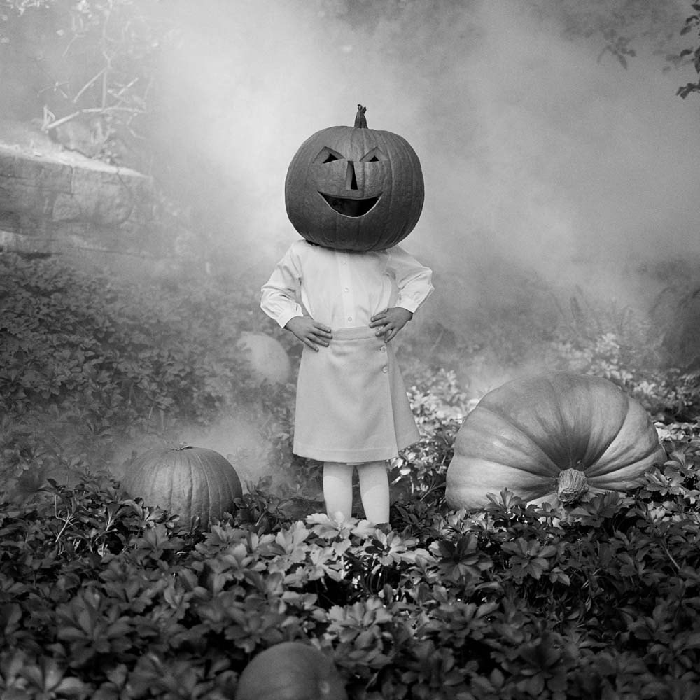 "<span class=""caption-title"">Mia with a Pumpkin Head</span>, Snedens Landing, New York, 2003<span class=""caption-copyright"">© Rodney Smith</span>"