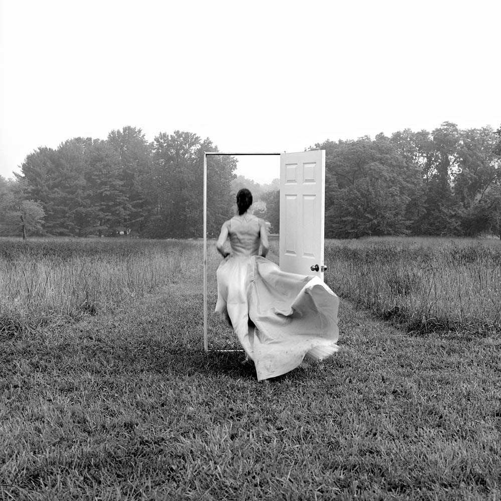 "<span class=""caption-title"">Caroline Running through Doorway</span>, Monkton, Maryland, 1999<span class=""caption-copyright"">© Rodney Smith</span>"