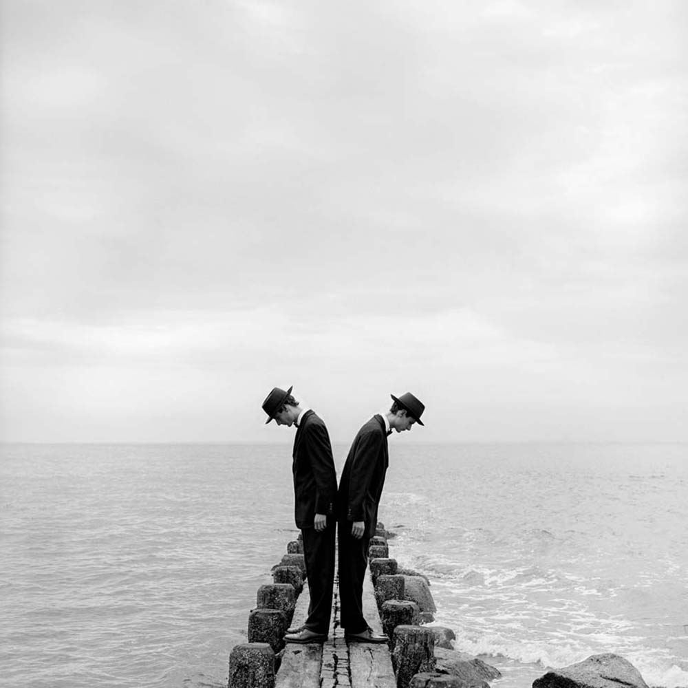 "<span class=""caption-title"">Twins Leaning Outward on Dock No. 1</span>, Sherwood Island, Connecticut, 1997<span class=""caption-copyright"">© Rodney Smith</span>"