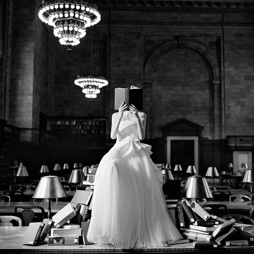 "<span class=""caption-title"">Flynn Reading on a Pile of Books</span>, New York, New York, 2012<span class=""caption-copyright"">© Rodney Smith</span>"