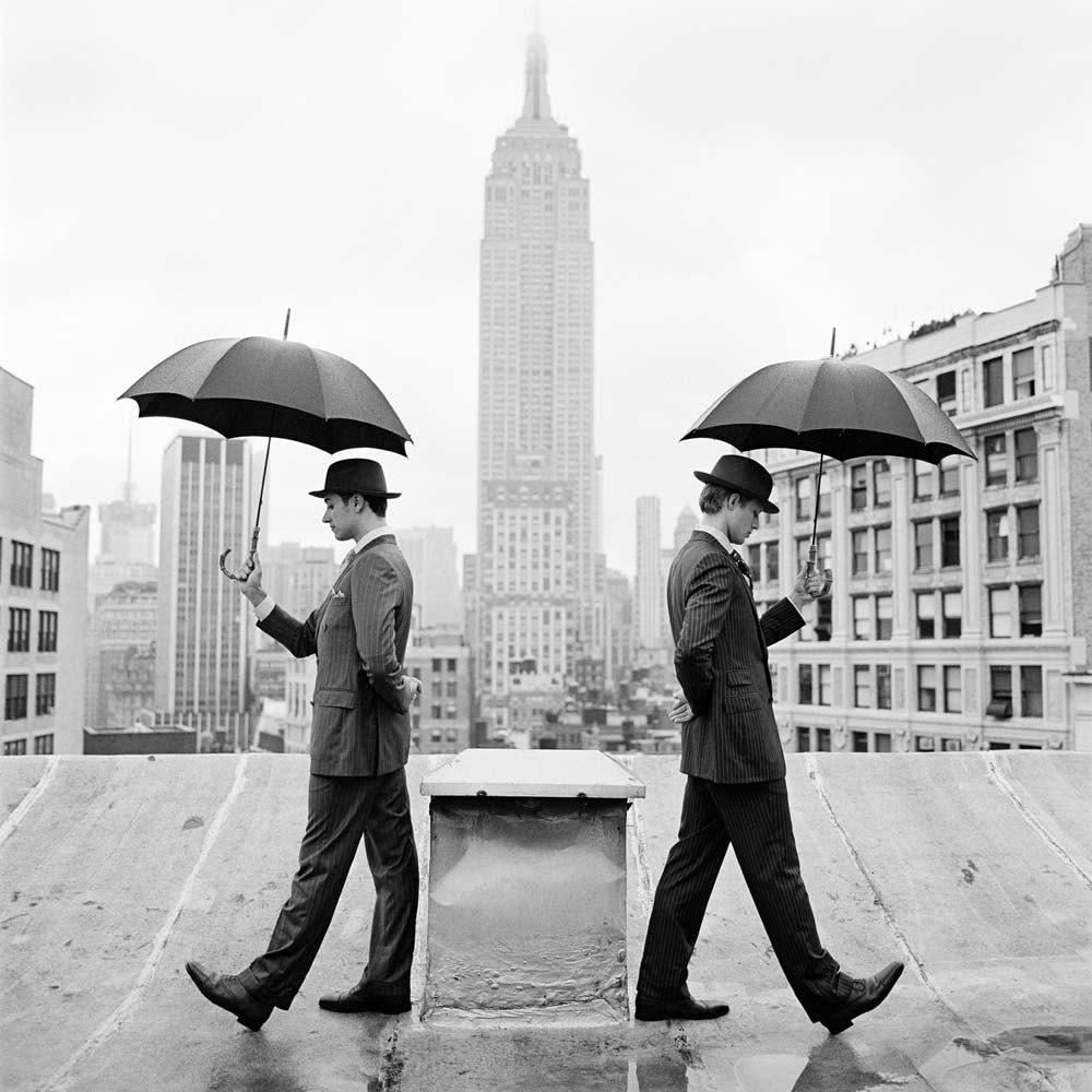 "<span class=""caption-title"">Reed and Nathan with Umbrellas on Rooftop</span>, New York, New York, 2011<span class=""caption-copyright"">© Rodney Smith</span>"