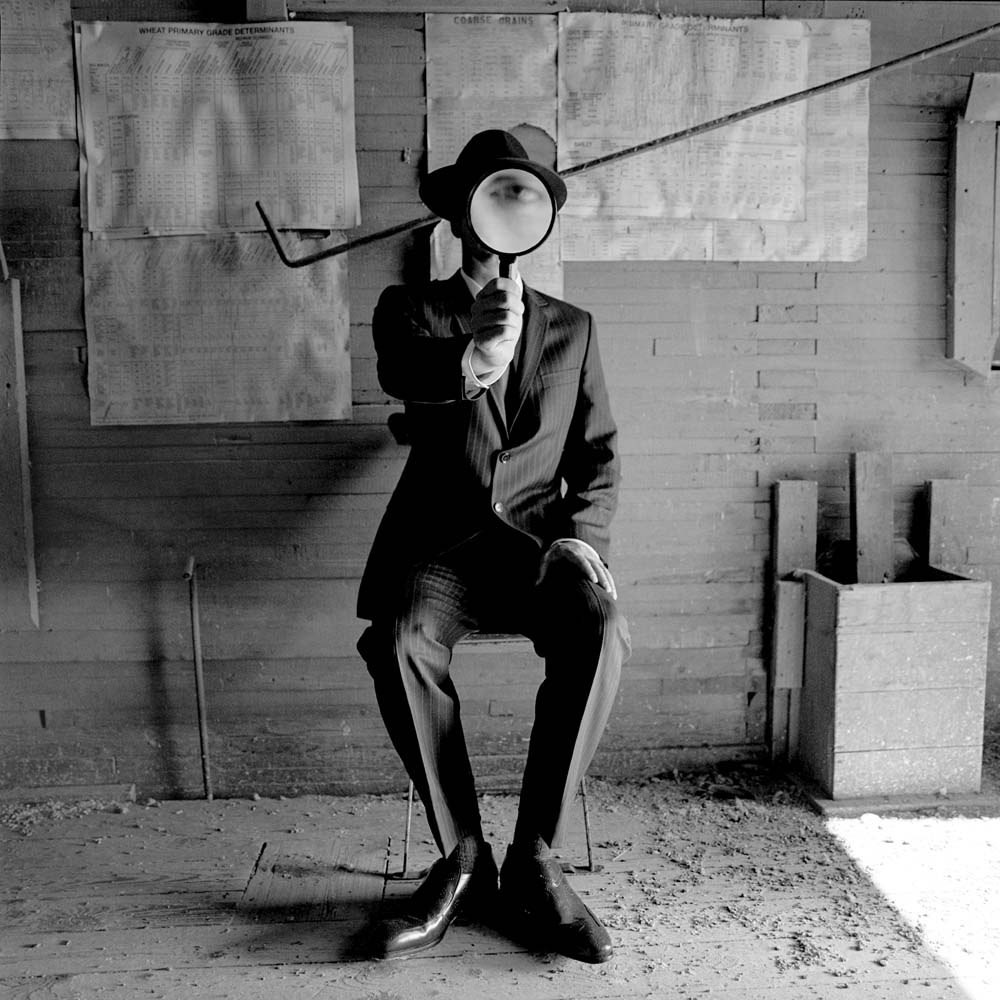 "<span class=""caption-title"">Collin with Magnifying Glass</span>, Alberta, Canada, 2004<span class=""caption-copyright"">© Rodney Smith</span>"