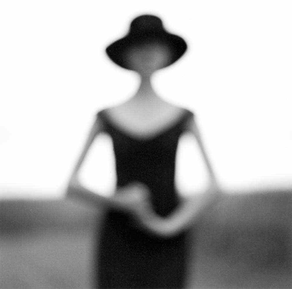 "<span class=""caption-title"">Blurry Woman with Hands Clasped</span>, Galena, Illinois, 1997<span class=""caption-copyright"">© Rodney Smith</span>"
