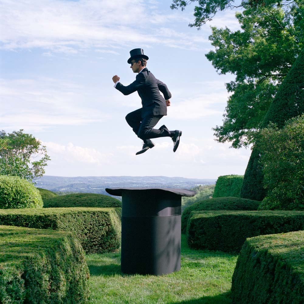 "<span class=""caption-title"">Reed Floating Above Giant Top Hat</span>, Amenia, New York, 2014<span class=""caption-copyright"">© Rodney Smith</span>"