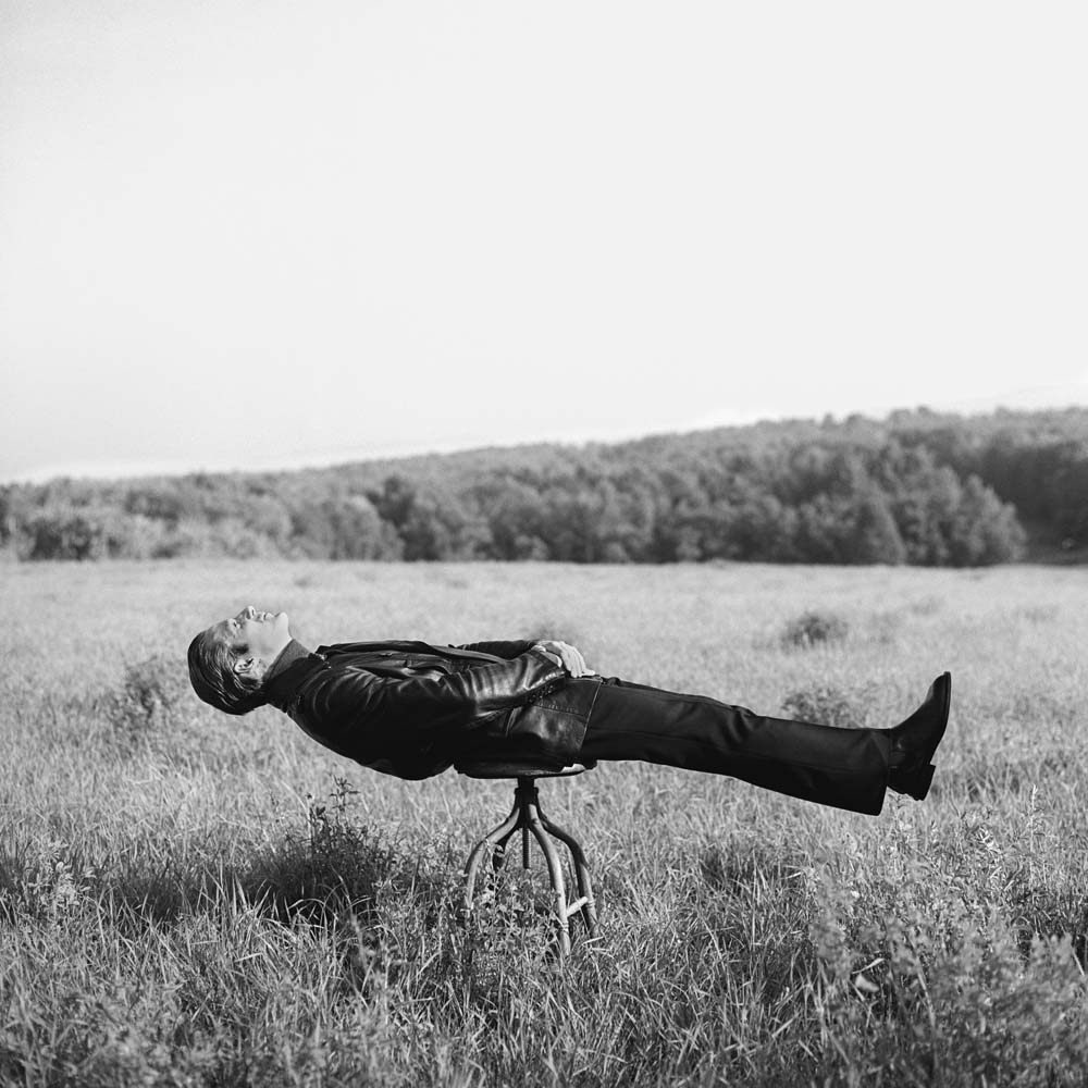 "<span class=""caption-title"">Don Lying on Stool</span>, Canterbury, New Hampshire, 1996<span class=""caption-copyright"">© Rodney Smith</span>"